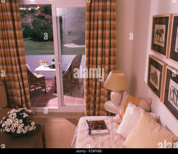 Traditional interiors livingrooms doors stock photos for Small room in spanish