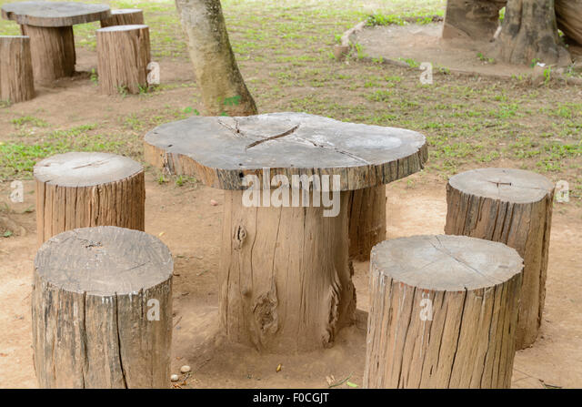 Stump Chair And Wooden Table In The Garden   Stock Image