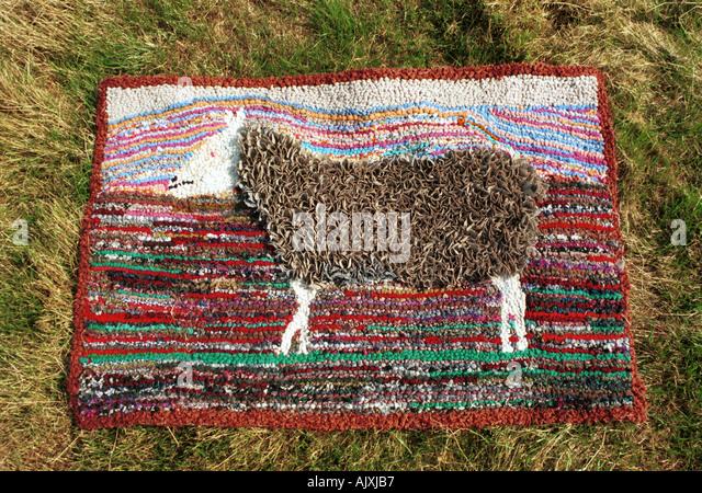 a rag rug depicting a sheep on a cumbrian farm uk john robertson stock