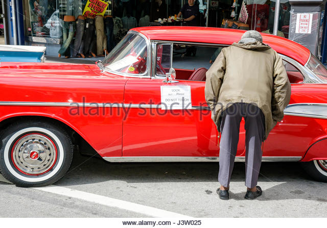 Red 1957 chevrolet stock photos red 1957 chevrolet stock for Selective motor cars miami