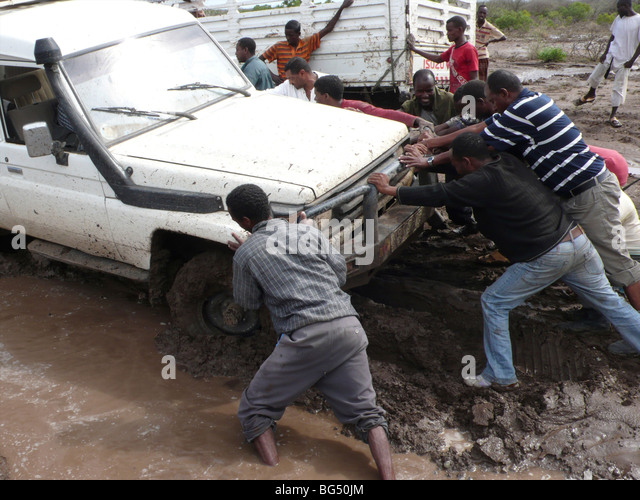 car stuck in mud how to get out