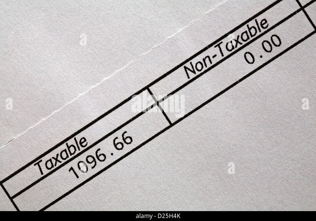 Taxable Non Taxable Boxes On Pay Advice Slip   Stock Image