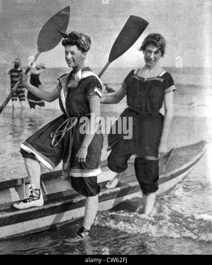 Vintage Pinup Girl Wearing Bathing Suit At The Ocean Stock: Bathing Suit 1900 Stock Photos & Bathing Suit 1900 Stock