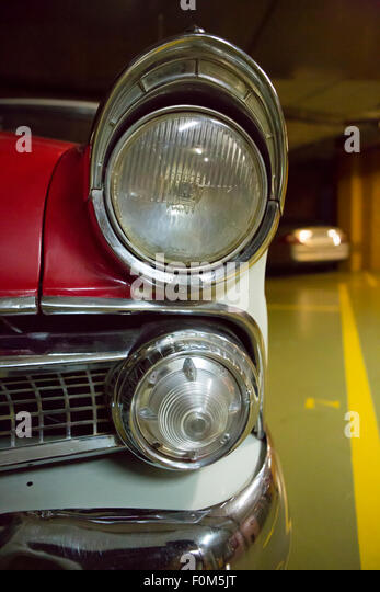 Classic Car Light Bulbs: Detail of the bumper and the light bulb of an American vintage car taken in  a,Lighting
