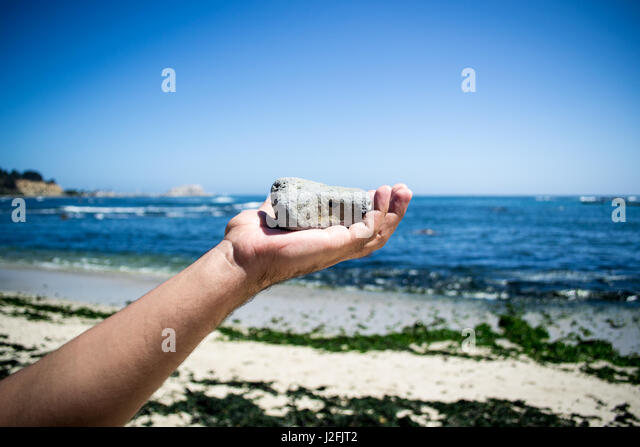 Hand Throwing Stone : Stone throwing stock photos images