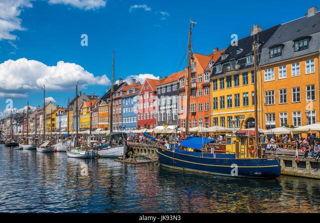 Nyhavn district is one of the most famous landmarks in Copenhagen, Denmark - Stock Image