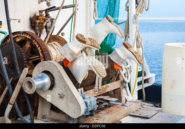 Wenches stock photos wenches stock images alamy for Commercial fishing boots