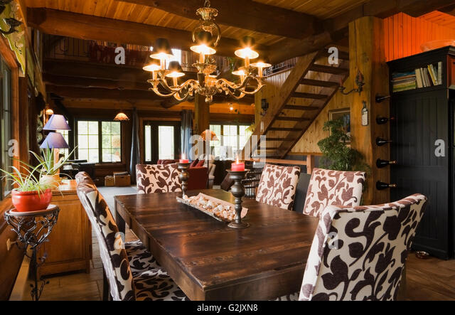Dining Room Wooden Table Upholstered Chairs Inside A Cottage Style Log Home Quebec Canada This Image