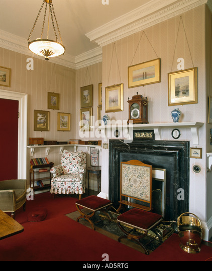 Firescreen In Front Of Fireplace Edwardian Livingroom With Wallpaper And Brass Coal Scuttle