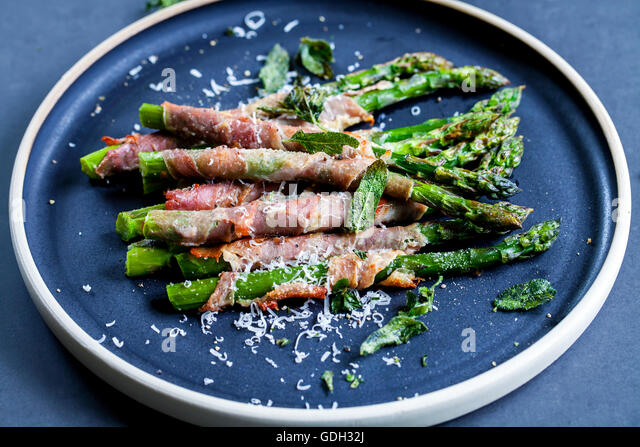 Grilled asparagus wrapped in Parma ham with parmesan, sage and thyme ...