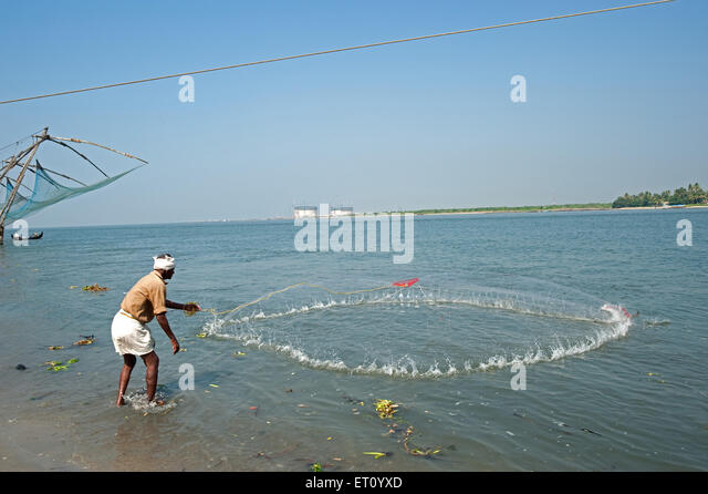 Fisherman throwing net stock photos fisherman throwing for Throw nets for fishing