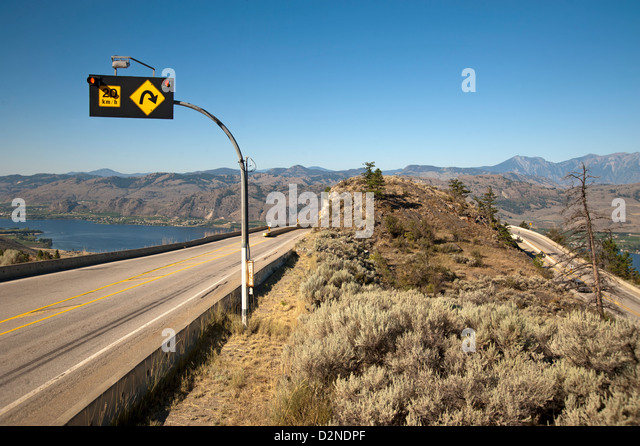 Winding road sign stock photos winding road sign stock images alamy winding road with warning sign upon entering osoyoos british columbia canada in the okanagan publicscrutiny Images