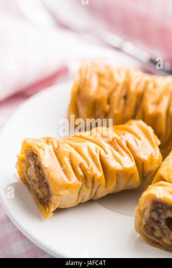 Sweet dessert baklava on white dessert plate. - Stock Image