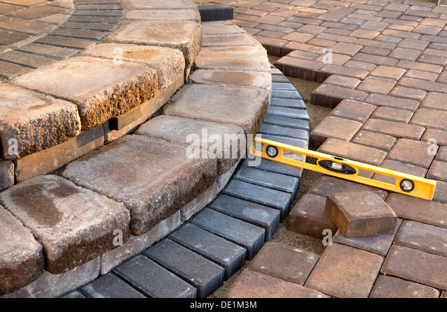 Pavers Meets With Patio Steps And Job Completion Almost Done, Last Check  With Yellow Level