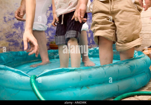Paddling pool family stock photos paddling pool family for Family paddling pool