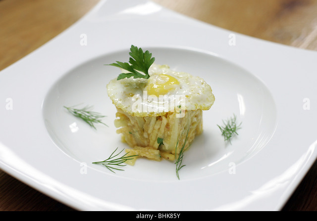 Portuguese scrambled eggs with codfish, potatoes and a fried egg ...