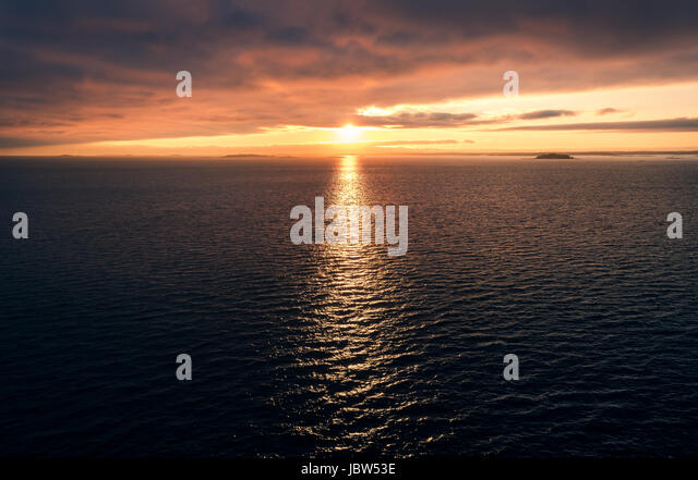 Scenic seascape with atmospheric sunset at evening in Gulf of Finland - Stock Image