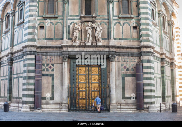 A tourist pauses to study the east doors of the Baptistery in Florence Italy. & Baptistery Doors In Florence Italy Stock Photos \u0026 Baptistery Doors ... Pezcame.Com