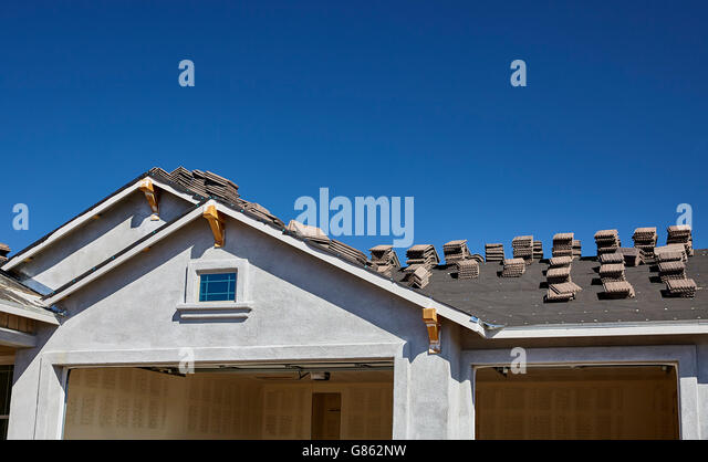 Roofing tile stock photos roofing tile stock images alamy for New home building contract