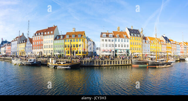 Copenhagen, Denmark - May 1, 2017: Nyhavn with its picturesque harbor with old sailing ships bobbing on the canals' - Stock Image