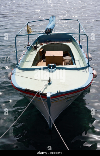 Small old blue motor boat stock photos small old blue for Small fishing boats with motor