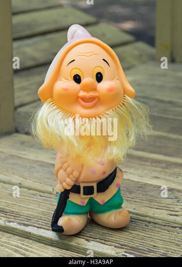 ... rubber toy in form of a bearded gnome for young children - Stock Image