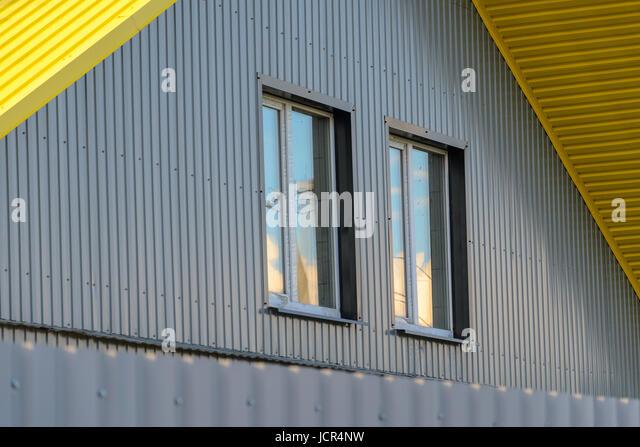 Aluminum corrugated metal facade stock photos aluminum corrugated metal facade pediment with two windows stock image sciox Images
