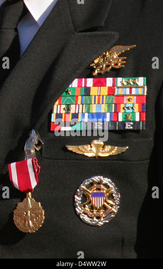 close up view of military decorations and honors on a commanders dress uniform - Military Decorations
