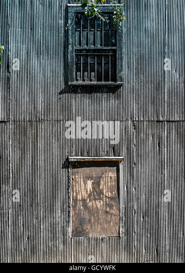 Corrugated metal building stock photos corrugated metal building close up of an old dark large corrugated metal building with boarded up windows and sciox Image collections