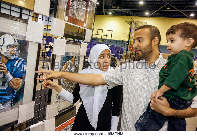 Miami Beach Miami Florida Beach Convention Center sports memorabilia collectibles for sale Mid Eastern family Muslim - Stock Image