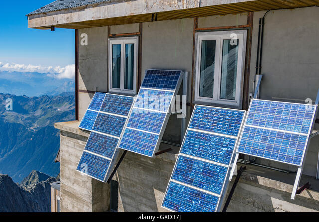 Solar Panel On Side Of Building : Solar panels on roof alpine stock photos