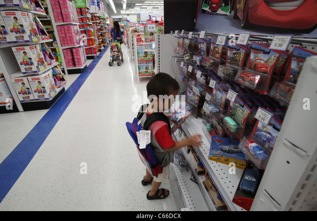 Little Boy With His New Backpack In Toys R Us Store Before New School Year
