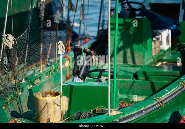 Drying boots stock photos drying boots stock images alamy for Commercial fishing boots
