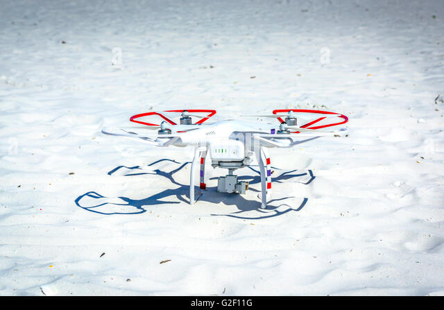 A Non Military Drone Sits On White Sand During Pre Flight Checklist Before Take