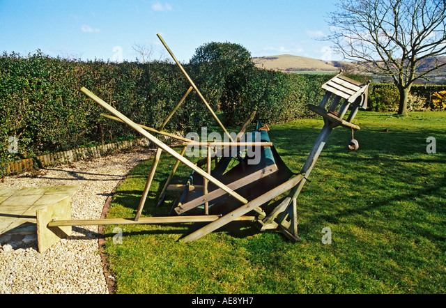 Medium image of storm damage gales uprooted anchored hammock lifting one paving stone and damaging the structure wiltshire uk