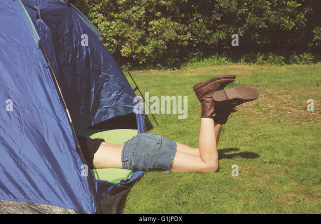 A young woman is lying in a tent with her legs sticking out - Stock Image & Legs Out Tent Stock Photos u0026 Legs Out Tent Stock Images - Alamy