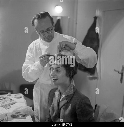 Friseur black and white stock photos images alamy for Garderobe junge