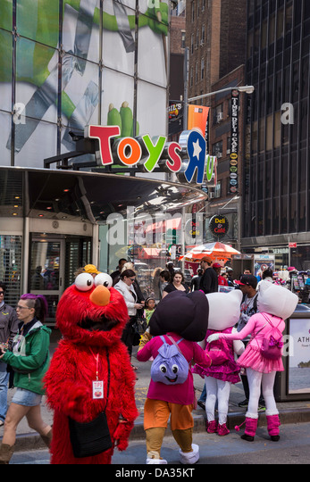 Toys R Us Cartoon Characters : Artist in times square stock photos