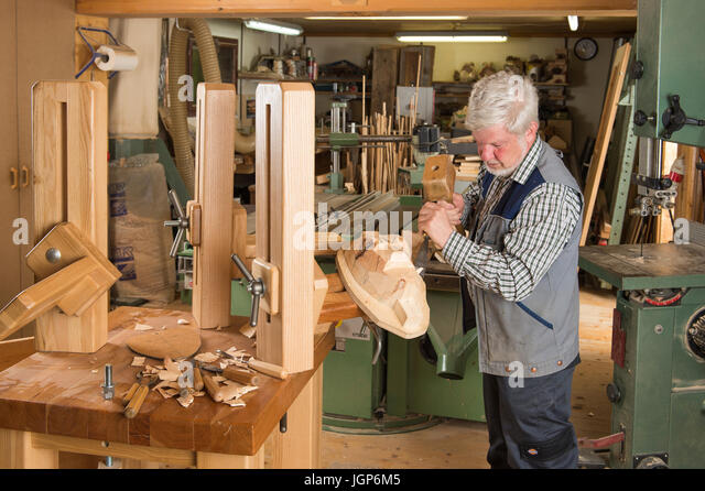 Carver carving stock photos images