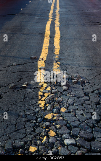 crumbling American road - Stock Image