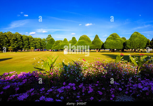 A perfect summer's evening at Hampton Court Palace showing the East Front Gardens with its beautiful herbaceous - Stock Image