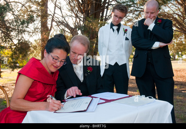 Civil wedding stock photos civil wedding stock images alamy a mature couple sign the register at their civil wedding ceremony in australia stock image junglespirit Image collections