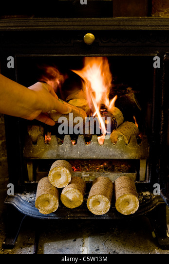 Compressed Wood Logs ~ Pellet fuel stove stock photos