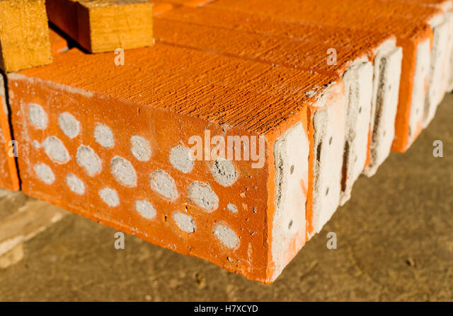Red Bricks With Holes Filled Cement