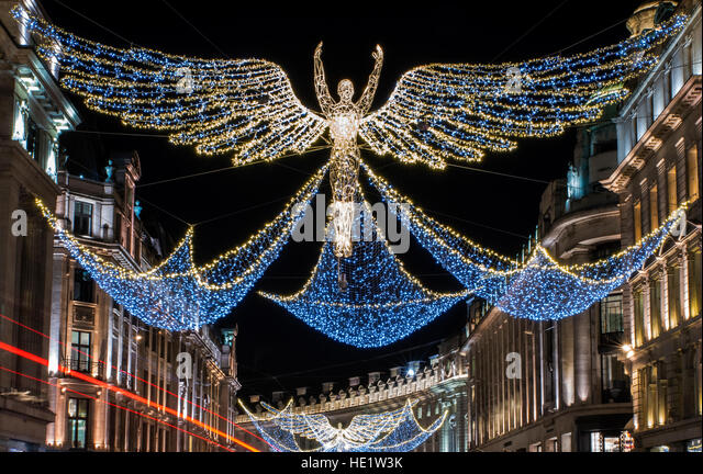 a view of the beautiful christmas lights in regent street central london stock