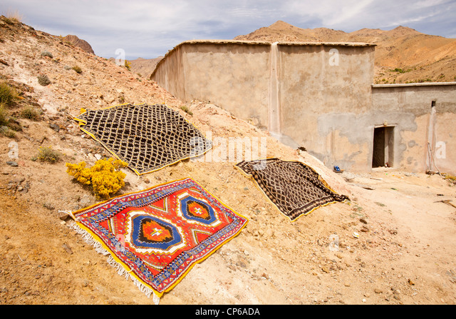 moroccan rugs outside a berber house in a valley in the anti atlas mountains of morocco