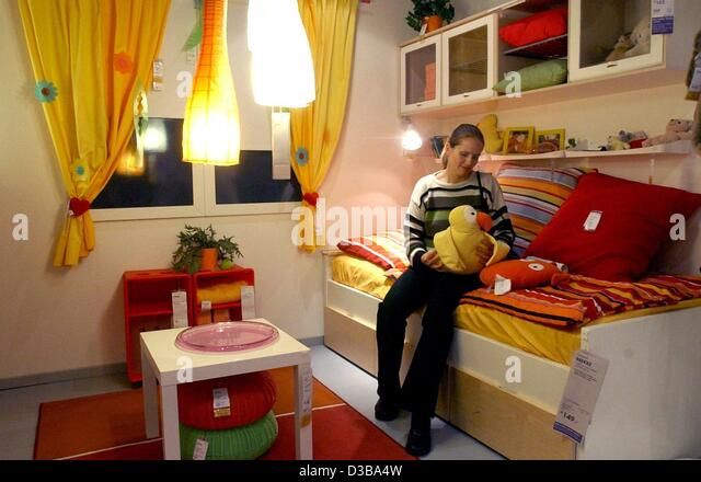 (dpa)   A Woman Is Checking Out Furnishing In A Showroom Of The IKEA