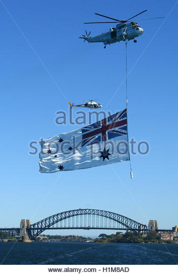 an-australian-navy-sea-king-helicopter-carries-an-australian-white-h1m8ad.jpg