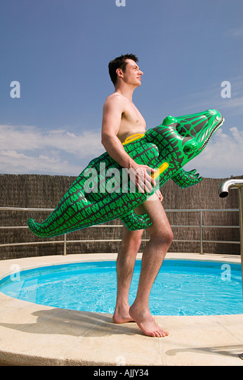 Man Carrying An Inflatable Crocodile   Stock Image