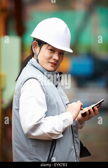 Goseong-gun South Korea  city photo : ... using smartphone at shipyard, GoSeong gun, South Korea Stock Image